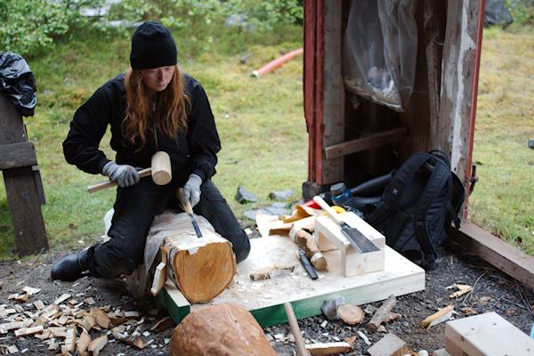 Working on a log during the 2016 Sorkfjord wood sculpture workshop.